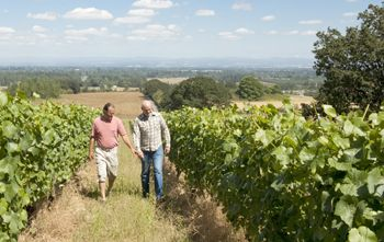 Raney and Erin Nuccio walk Le Puits Sec. Nuccio, the winery s new owner, plans to continue dry farming practices.