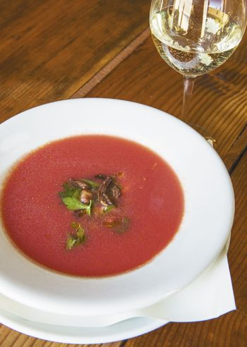 The chilled tomato soup with savory pork cracklins was inspired by a late night BLT the chef ate while tasting the Natalies s Estate 2010 Elephant Mountain Viognier. Photo by Andrea Johnson.