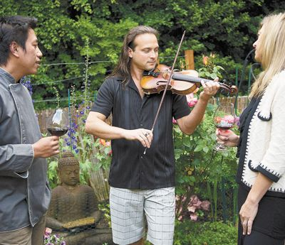 In his home garden in Portland, Aaron Meyer entertains guests, including his wife, Renée, and celebrity Thai chef Sonthaya Kaewpradit (Surin Beach Hotel