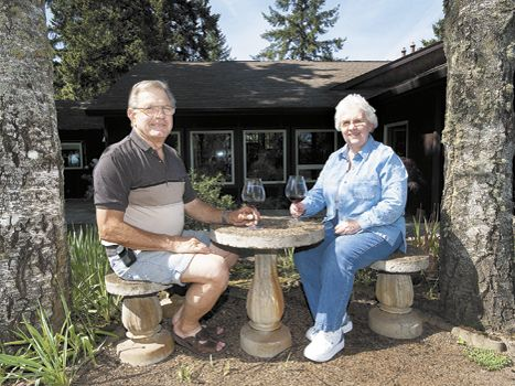 Joe and Shari Lobenstein share a bottle of Oregon wine at their B&B located outside of Carlton. Photo by Marcus Larson.