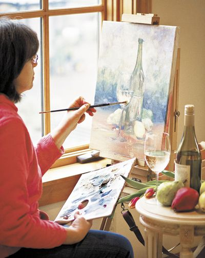 Amity artist Toni Tyree paints a still life of Chardonnay at Red Ridge Farms in Dayton.