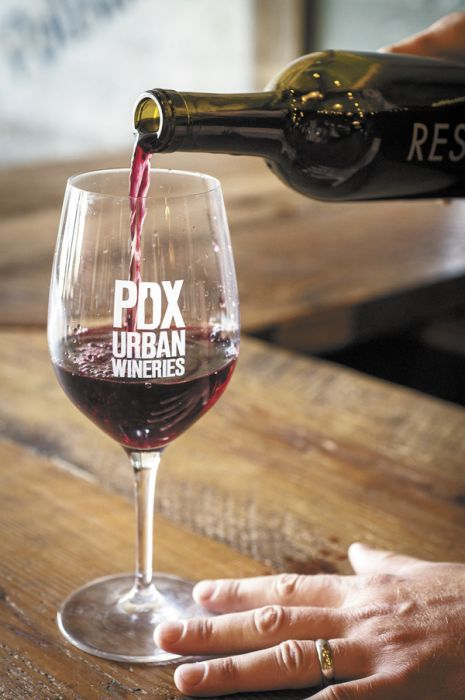 Ryan Lee Sharp of ENSO Winery in Southeast Portland pours a glass of his second label, Resonate, a blend of Mourvèdre, Cinsault and Grenache. ENSO is a proud member of PDX Urban Wineries, a relatively new association of city producers. Photo by Andrea Johnson.