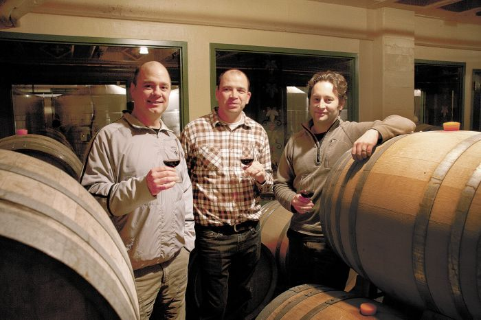 The McMenamins winemaking team (left to right): Clark McCool, director of winery and distillery operations; Davis Palmer, winemaker; and Nate Wall, assistant winemaker and enologist. Photo by Peter Szymczak.