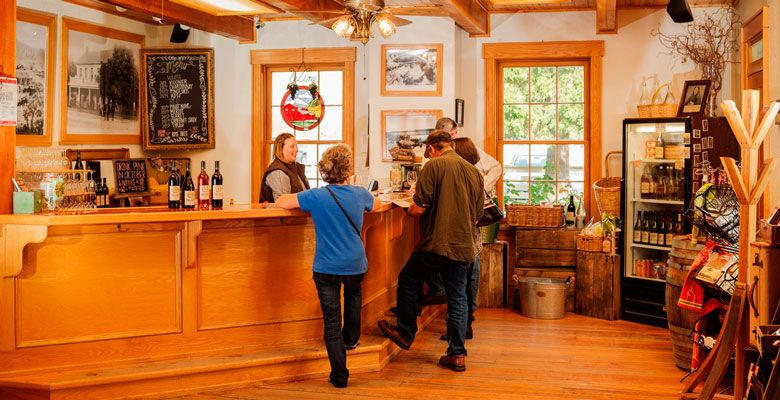 Courtney Thomas welcomes guests at Del Rio Vineyards in Gold Hill. ##Photo by Kathryn Elsesser