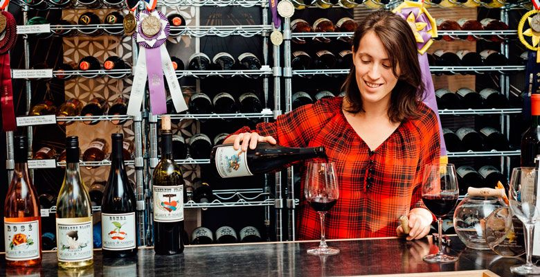Anna Mantheakis pours a sample for tasters at Quady North's tasting room in Jacksonville. ##Photo by Kathryn Elsesser