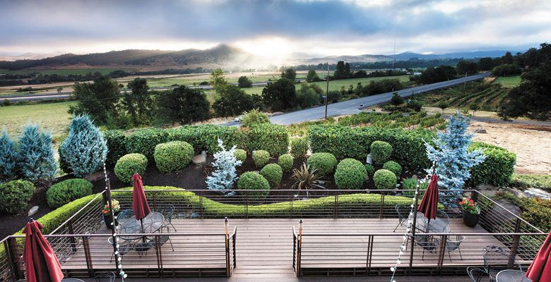 The deck at Weisinger Family Winery, located in Ashland, gives visitors a gorgeous view of the surrounding Rogue Valley. ##Photo by Mark Mularz