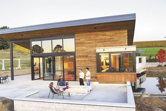 The modern firepit acts as a gathering place on the expansive patio.