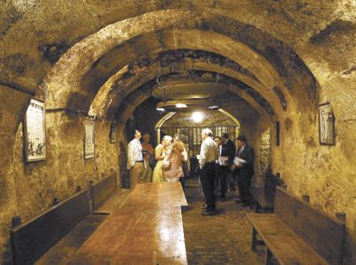 A group of Roseburg residents, including Abacela's Earl Jones and SOWI's Dwayne Bershaw, visited a wine cellar underneath the historic center of Aranda de Duero in Spain's wine region along the Duero River.