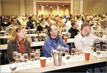 "Symposium attendees like Sean Driggers of Pudding River Cellars (middle front) and Joshua Wilkinson of Ponzi (far right) attend a session titled ""Under Cover: Vineyard Floor Management to Manipulate Vines and Wines."" The session include a wine tasting revealing different cover crops' effect on taste."