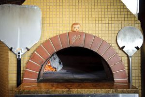 Dolly, the Patron Saint of Pizza  guards the wood-fire oven at the Firehouse in Northeast Portland.