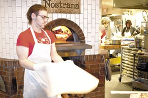 Joshua Shaham, Cathy Whims and Hilary Berg talk pizza and passion at Nostrana in Portland.  Photo by Andrea Johnson.