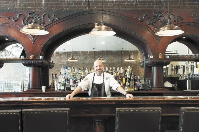 Chris Czarnecki behind the bar at The Barlow Room, the Joel Palmer House executive chef's new Dayton restaurant.Photo by Marcus Larson