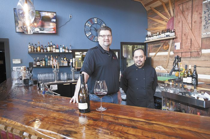 Barrel 47 owner Andy Rabung and chef Bono Solorzano behind the custom bar at the new Carlton eatery.