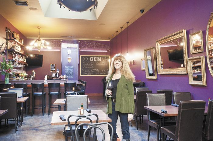 Kathy Stoler, owner of Gem Creole Saloon, stands amid the restaurant's jazzed up interior. Photo by Marcus Larson