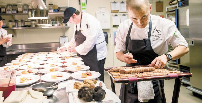 Executive Chef Sunny Jin prepares one of many truffled courses during the dinner at The Allison. Both black and white truffles were featured. ##Photo by John Valls.