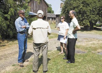 Farmer Charlie Chegwyn, left, talks with a farm visitor, Kamal Kotaich and Marie Vicksta of the Soil & Water Conservation District on a recent tour of historic Chegwyn Farms.  Photo by Marcus Larson
