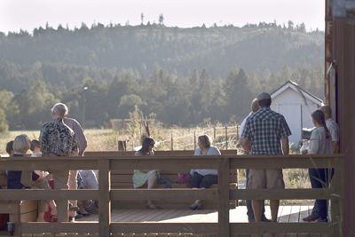 Guests mingle outside the barn before the dinner begins. Photo provided.