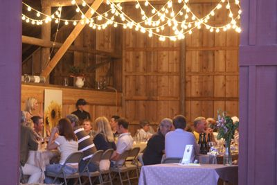 Guests enjoy a Barn Dinner prepared by Heidi Tunnell.  Photo provided.