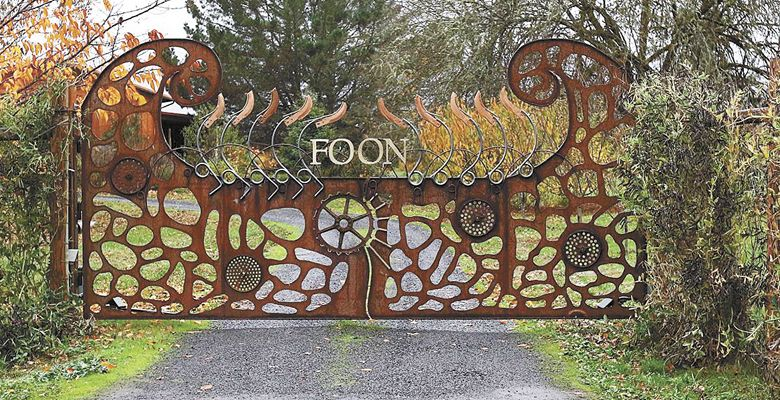The gate at FOON Estate was designed by Feldman, who used old farming implement parts. ##Photo provided