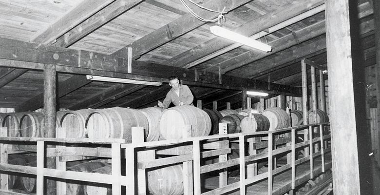 Richard Sommer tends to barrels in the early years at HillCrest Vineyard. Although he died in 2009, his memory lives on through the winery he founded and his wine industry legacy. ##Photo courtesy of LInfield College Archives