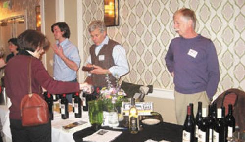 Luke Bradford of Cor Cellars (far left) chats with a taster during the Columbia Gorge AVA event at the Hotel Monaco in Portland as Cor s Ed Cornell (center) and Rob Bell of Cathedral Ridge (far right) look on.