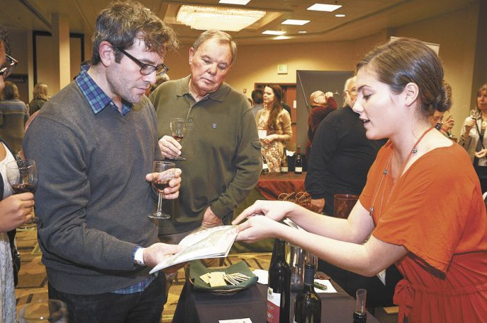 Jade Ostner pours Maryland wines at the Great American Wine Festival in Portland. Photo by Andrea Johnson.