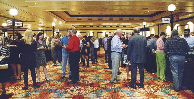Guests mingle during the 2016 Greatest of the Grape at Seven Feathers Casino Resort. ##Photos by Angela Chenowith | www.chenowethphotography.com