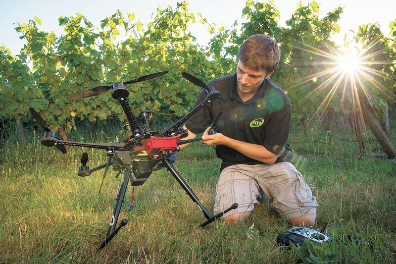 Stephen Burtt, co-founder of Aerial Technology International, readies his ATI hexacopter with MicaSense RedEdge sensors for a fly over Carlo & Julian Vineyard near Carlton to gather multispectral imaging for analysis. ##Photo by Andrea Johnson