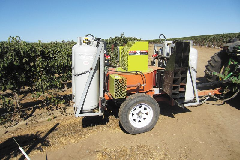 Agrothermal Systems manufactures equipment that blows hot air (300°F) into the canopy from propane-powered jets in order to control pests and diseases without harming the grapevine. Additional benefits include assuring fruitset and improving wine quality. ##Photo courtesy of Agrothermal Systems