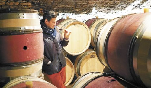 Louis-Michel Liger-Belair samples wine from the barrels of his family's winery, Domaine du Comte Liger-Belair. ##Photo by Steen Öhman/Winehog.org