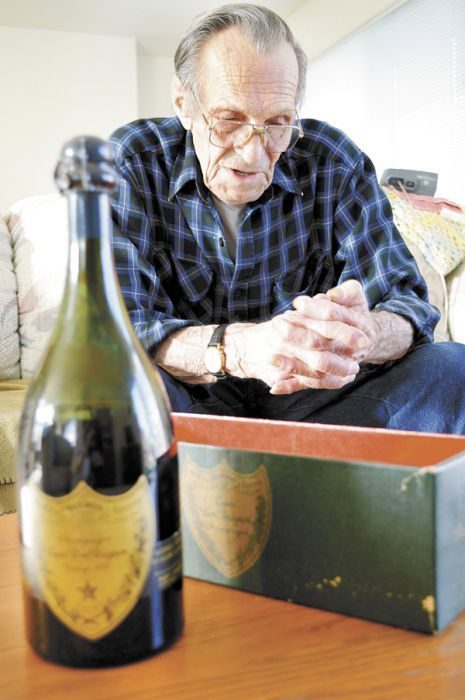 Charles Hackett, an 82-year-old retired timber worker, is the proud owner of a 1943 Dom Pérignon. Photo by Janet Eastman.