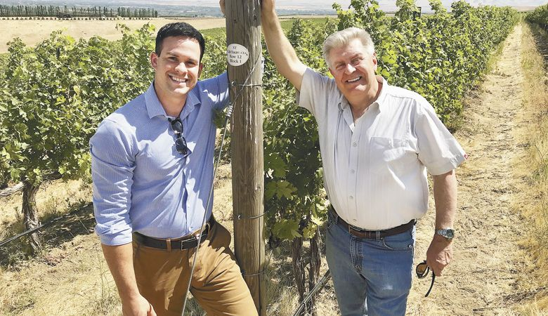 Hanatoro Winery owners Kevin Bozada and Steve Thomson check their Cabernet Sauvignon vines at Octave Vineyard in the Walla Walla Valley.  ##Photo provided