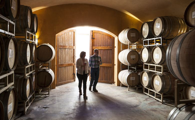 Laurine and Alfredo Apolloni of Apolloni Vineyards walks in their barrel room located on the estate, which is situated in the soon-to-be called Tualatin Hills AVA. ##Photo provided