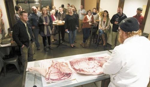 Chef Red Hauge demonstrates butchering a pig prior to a dinner centered on seasonal ingredients. ##Photo by Rockne Roll