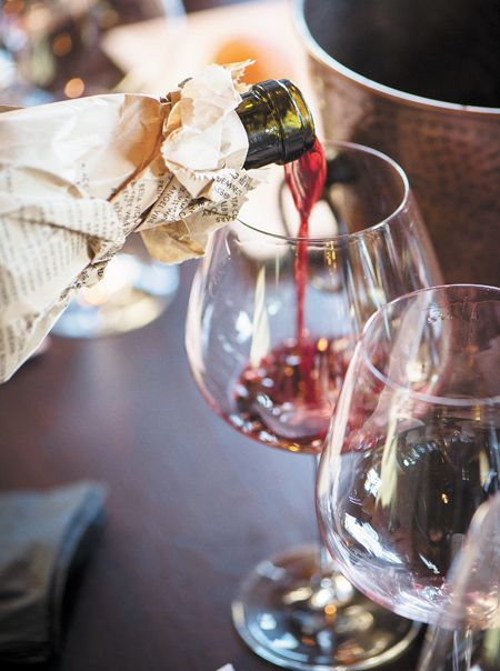 Wine is poured for a premium Pinot Noir blind tasting featuring wines priced at $100 or more.