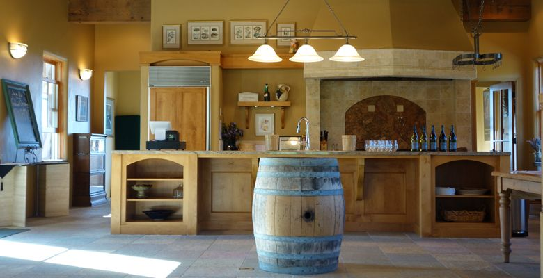 The tasting room offers warm colors and rustic wood. ##Photo provided