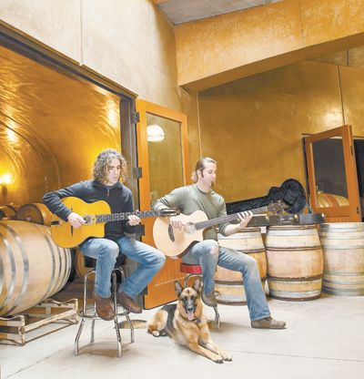 Jay Somers, winemaker/co-owner of J. Christopher Wines plays a tune with assistant winemaker Tim Malone at the Newberg winery. Cellar dog Nina listens to the music. Andrea Johnson/www.andreajohnsonphotography.com