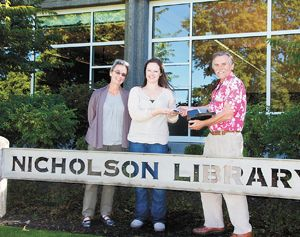 From left: Linfield Library Director Susan Barnes Whyte, archivist Rachael Woody and Janis Miglavs.