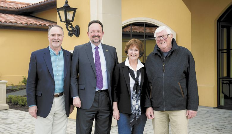 Linfield University Center for Wine Education Director Greg Jones, former Linfield President Thomas Hellie, and Grace and Ken Evenstad celebrate the endowment at Domaine Serene outside Dayton in 2018. 