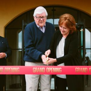 Culinary icon Emeril Lagasse watches as owners Ken and Grace Evenstad cut the ribbon of The Clubhouse at Domaine Serene, a 34,000-square-foot event facility on the winery's estate vineyard. ##Photo Courtesy of Domaine Serene