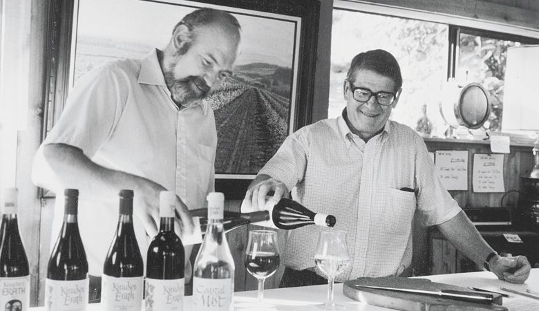Dick Erath (left) and Cal Knudsen pour glasses of wine from Knudsen Erath Winery.