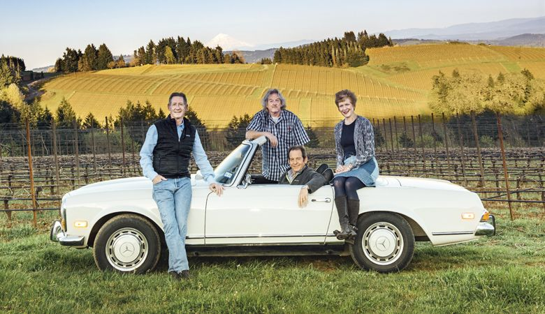 Colin Knudsen (from left), Cal Knudsen, David Knudsen and Page Knudsen Cowles shown with Cal and Julia Lee Knudsen's 50-year-old 1970 Mercedes 280 SL purchased just before the 1971 founding of Knudsen Vineyards. ##Photo by Kathryn Elsesser