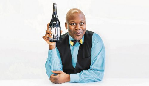 Burgess holds a bottle of his wine inspired by the song that became an Internet and meme sensation. ##Photo courtesy of Fine Wine Agency