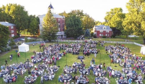 Guests at the 2017 International Pinot Noir Celebration gather in the Oak Grove at Linfield College for another successful event. ##Photo by Andrea Johnson