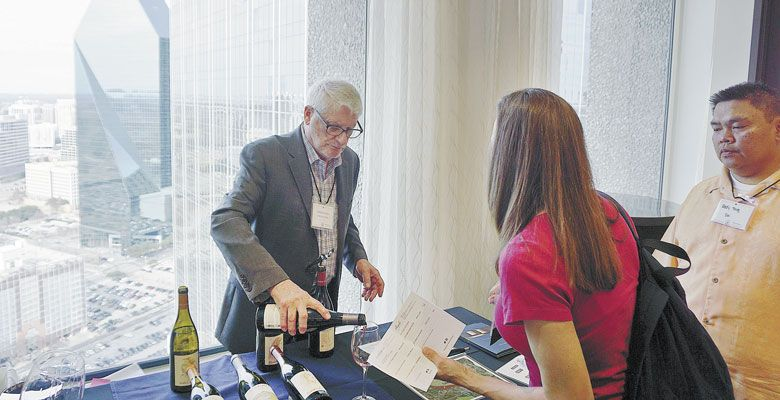 David Adelsheim pours his namesake wine at the Pinot in the City event in Dallas, Texas. ##Photo by Dan Eierdam
