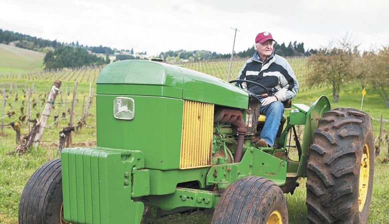 Jim Maresh on his tractor in the Dundee Hills. ##Photo by Del Munroe