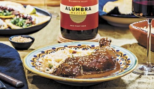 Molé Poblano paired with Alumbra Cellars 2019 Mezcla Pinot Noir. Recipe from Miguel Marquez, based on his abuela's recipe served in Mexico City since 1961. ##Photo by Kathryn Elsesser