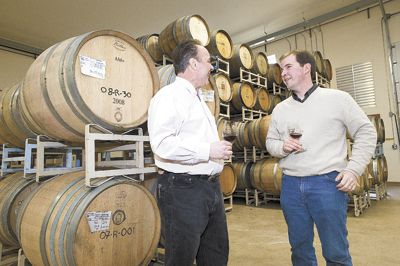 David Bergen, of Tina s Restaurant, and Russel Gladhart, of Winter s Hill, discuss land-use issues at Gladhart s winery.  Both were selected to be part of an expert panel.  Photo by Marcus Larson, News-Register.