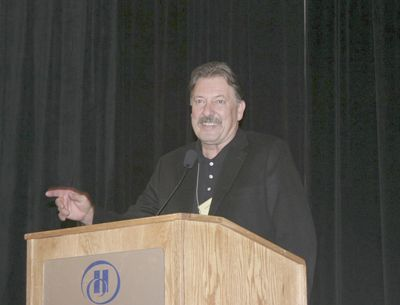 Lonnie Wright, of the Pines 1852 in the Columbia Gorge, receives the Lifetime Achievement Award from the Oregon Wine Board at this year s Oregon Wine Symposium.  Photo courtesy of OWB.