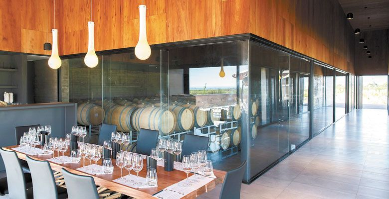 A sleek, modern interior allows visitors to view the barrel room at Corazon del Sol. ##Photo provided.